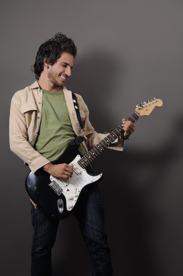 sexig gitarrist arkivbild