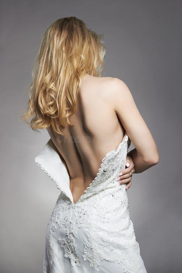 Sexig härlig baksida av brudkvinnan royaltyfria foton