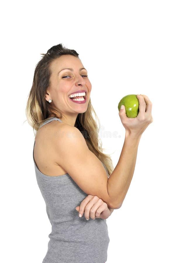 Sexig härlig frukt för äpple för kvinnainnehavgräsplan i sunt naturligt näring- och konditionbegrepp arkivfoto
