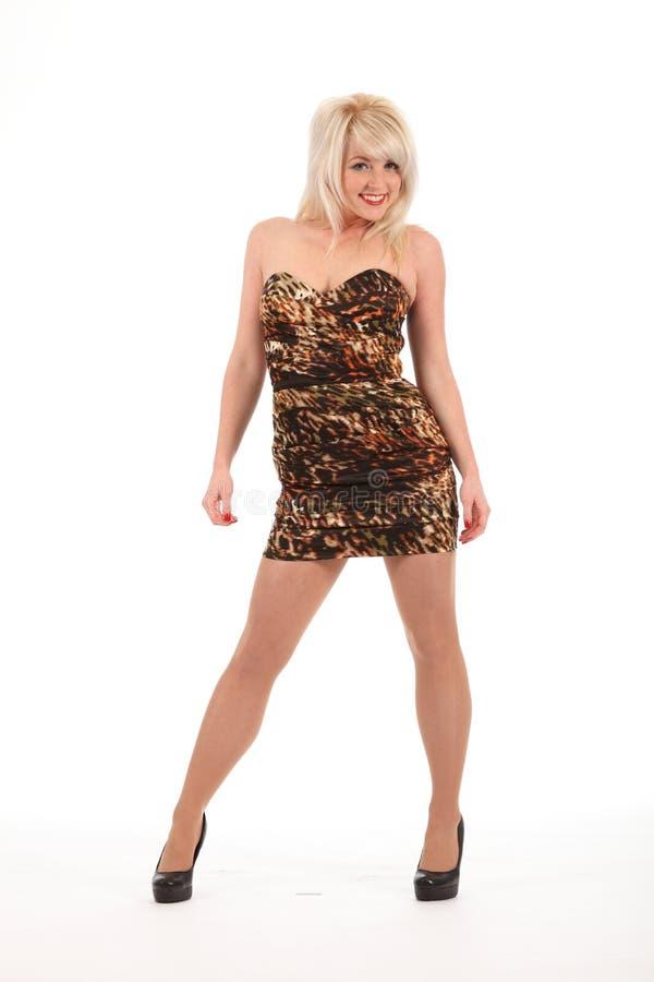 sexig kortslutning för blonda häl för klänningflickahapp royaltyfria foton