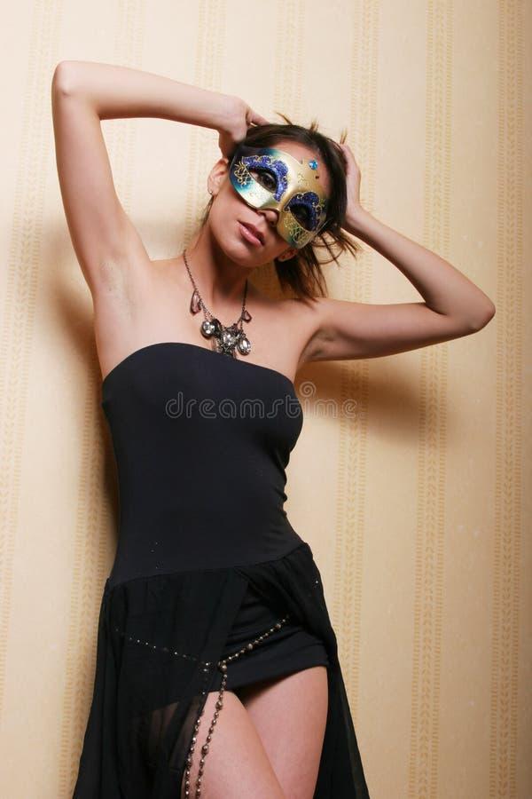 sexig kvinna för brunettmaskering royaltyfria foton