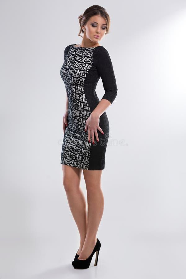 Sexig kvinna i klänning royaltyfri foto