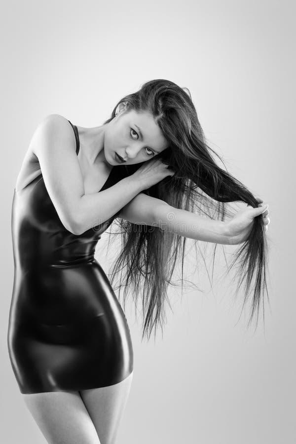 Sexig kvinna i latex fotografering för bildbyråer