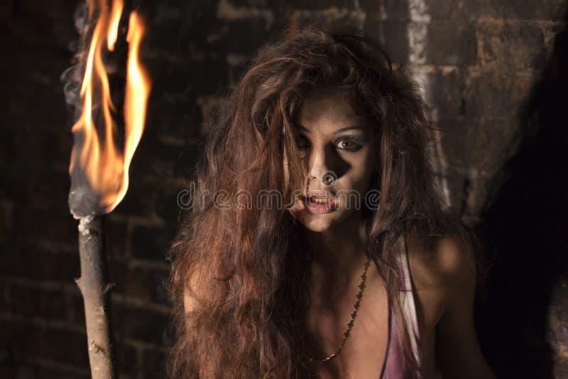 Sexig kvinna med facklan i hand royaltyfri fotografi