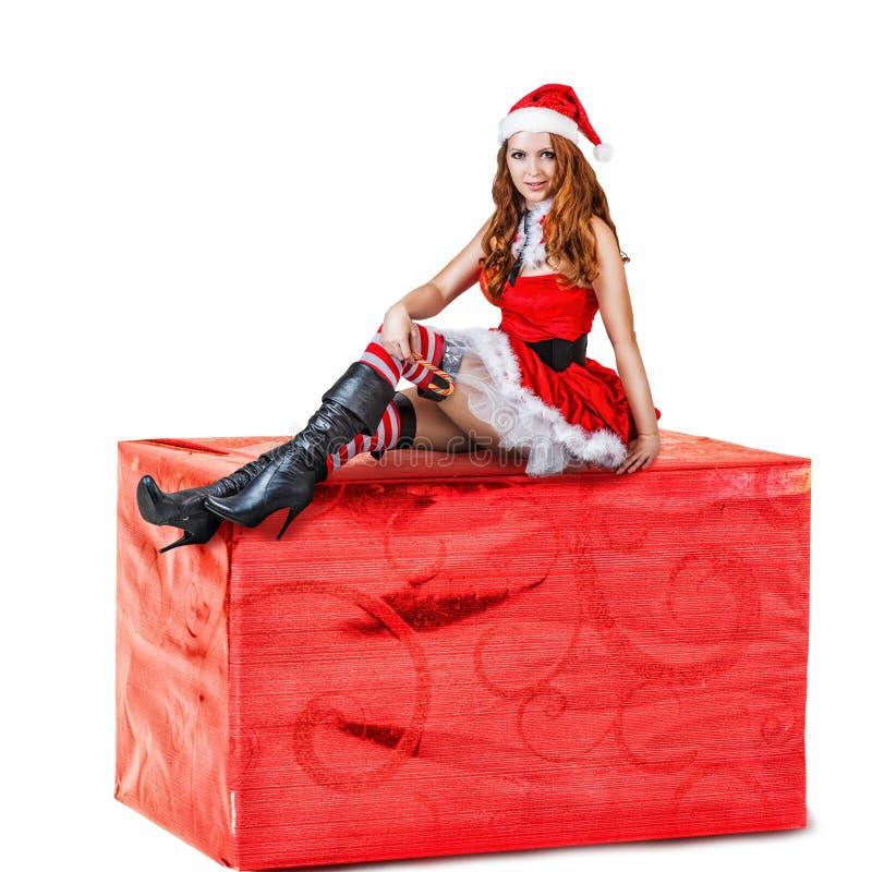 Sexig kvinna som bär röd Santa Claus kläder arkivbild