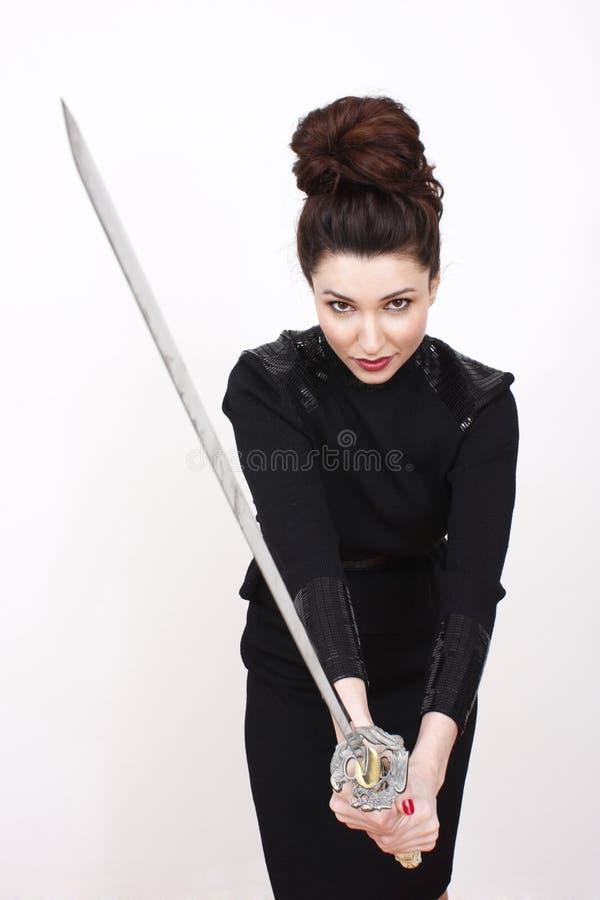 sexig svärdkvinna royaltyfri bild