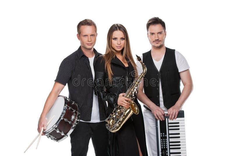 Sexig trendig jazzband som poserar på kamera. royaltyfri foto