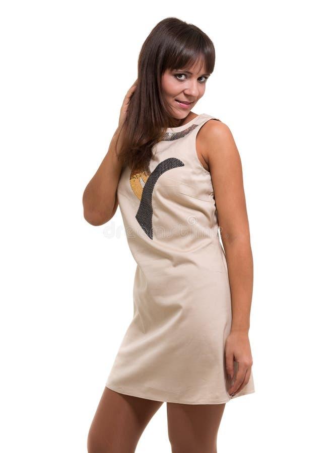 Sexig ung kvinna i lite klänningen som isoleras på vit royaltyfri fotografi