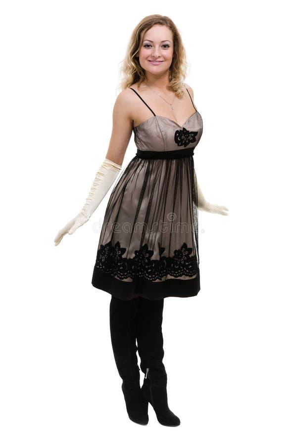Sexig ung kvinna i lite klänningen som isoleras på vit royaltyfria bilder