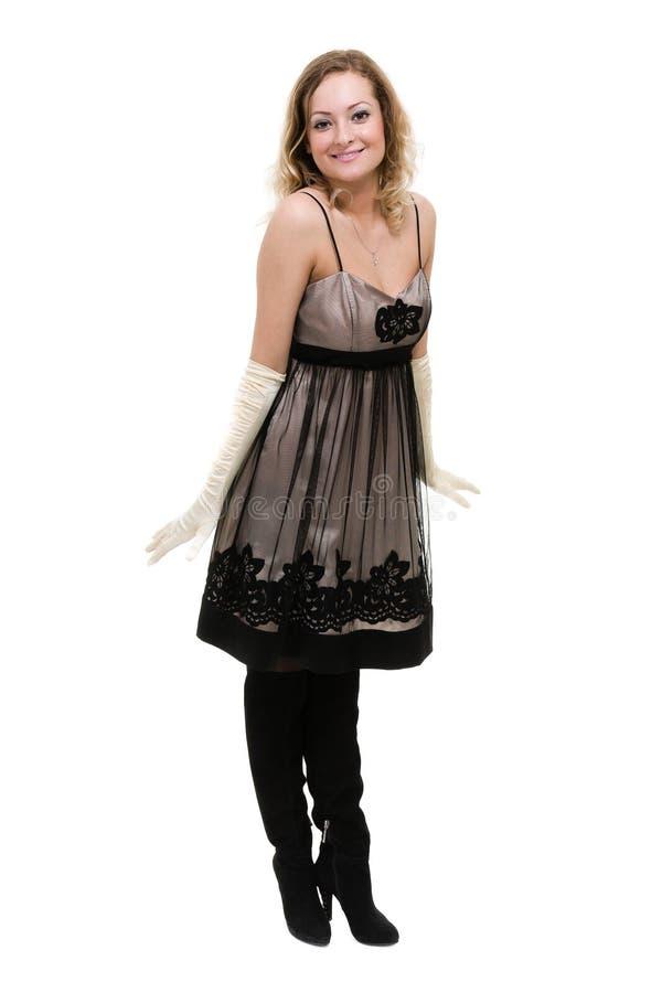 Sexig ung kvinna i lite klänningen som isoleras på vit royaltyfria foton