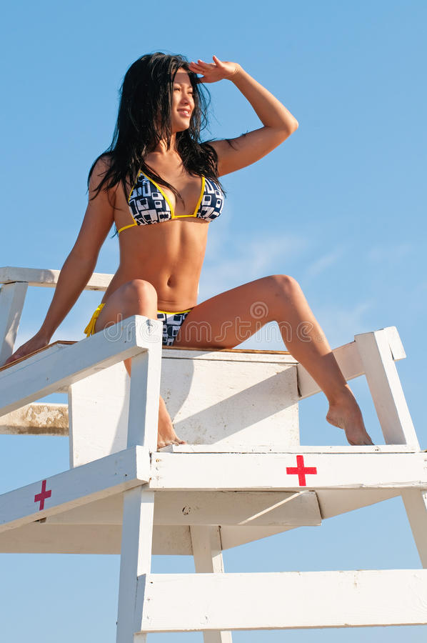 sexig working för bikinilivräddare royaltyfri bild