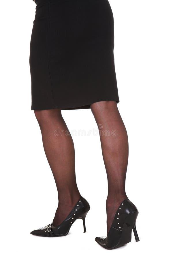 sexiga affärskvinnaben royaltyfri fotografi
