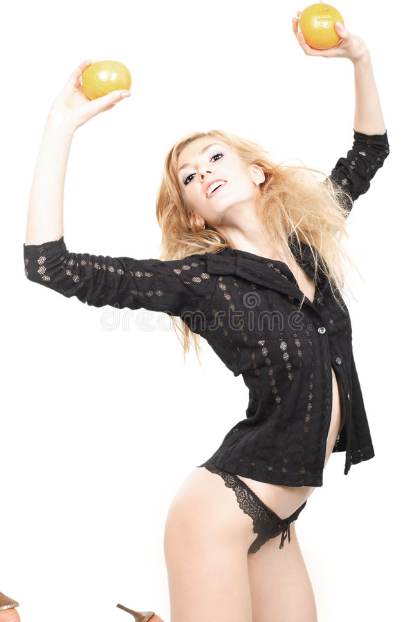 sexiga blonda orranges fotografering för bildbyråer