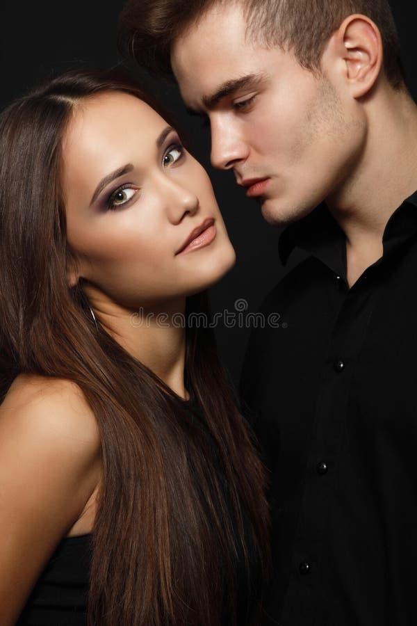 Sexiga passionpar, härlig ung man och kvinnacloseup, dubb royaltyfri fotografi