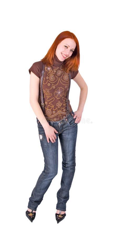 sexiga suspenders för flickajeans royaltyfri bild