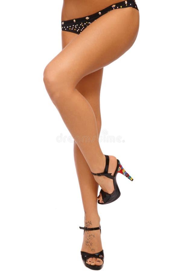 sexigt brunbränt för ben arkivfoton