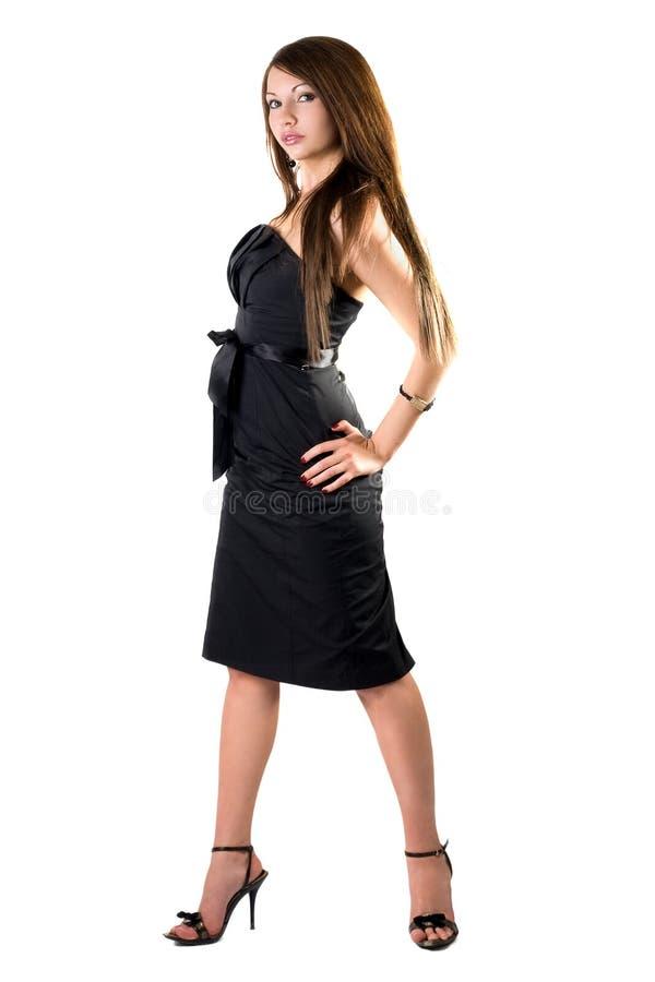 sexigt kvinnabarn för svart klänning fotografering för bildbyråer
