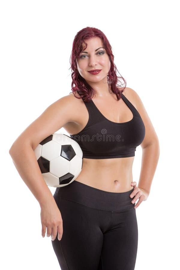 Sexigt kvinnligt anseende och innehav en boll royaltyfria foton