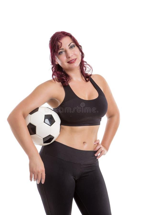Sexigt kvinnligt anseende och innehav en boll royaltyfri fotografi