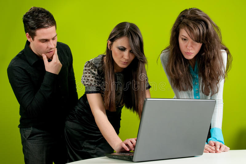 Sexual Abuse. Two women being watched bytheir male colleague in the office royalty free stock photography