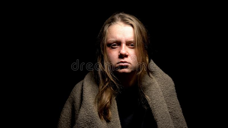 Sexual abuse victim looking on camera, tired of tortures, domestic violence. Stock photo stock photos