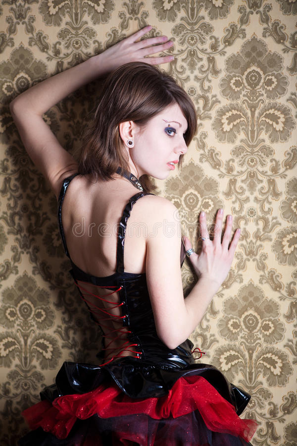 Sexual girl blonde in gothic clothes stock images