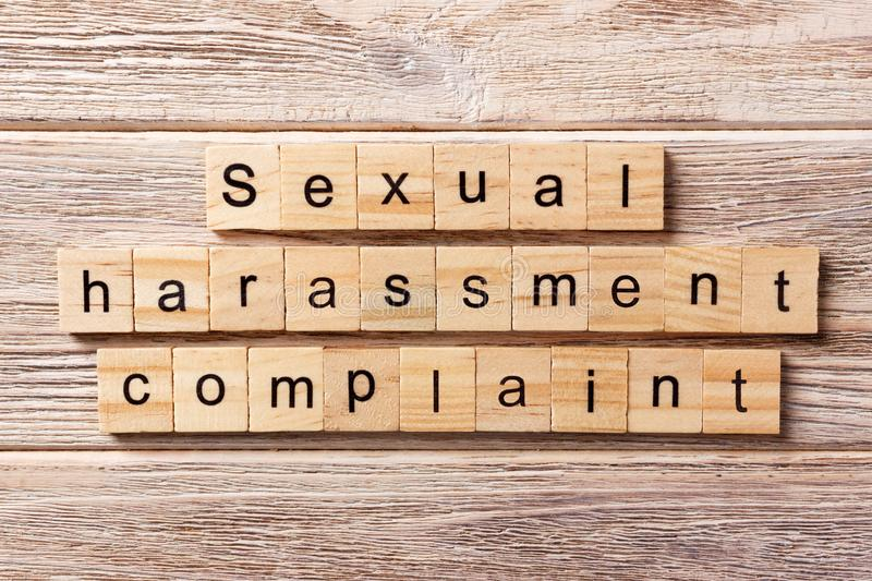 Sexual harassment complaint word written on wood block. Sexual harassment complaint text on table, concept stock photography