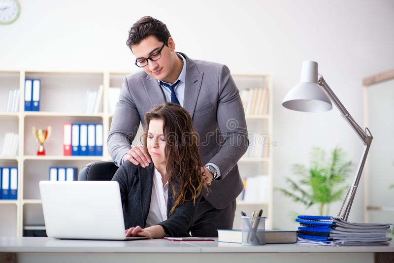 The sexual harassment concept with man and woman in office royalty free stock images