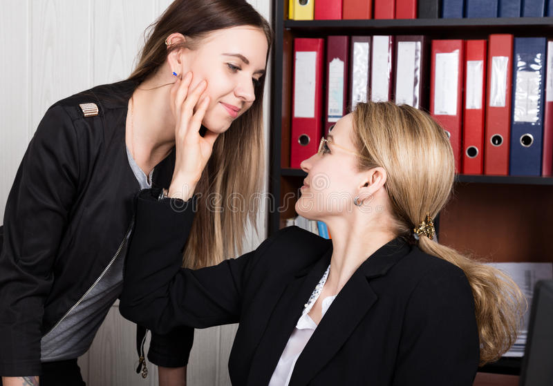 Sexual harassment. female boss sexually molested the female employee.  stock images