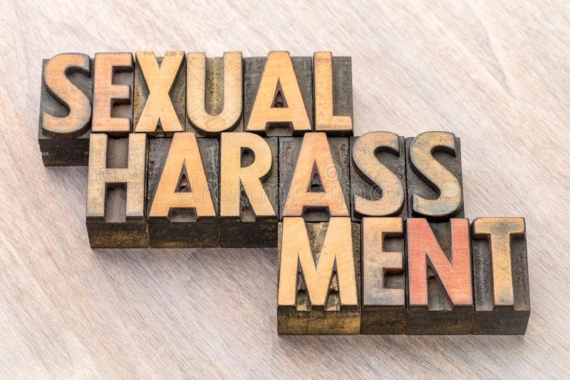 Sexual harassment word abstract in wood type stock images