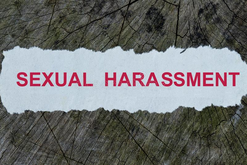 Sexual harassment word on a cut out newspaper royalty free stock photos