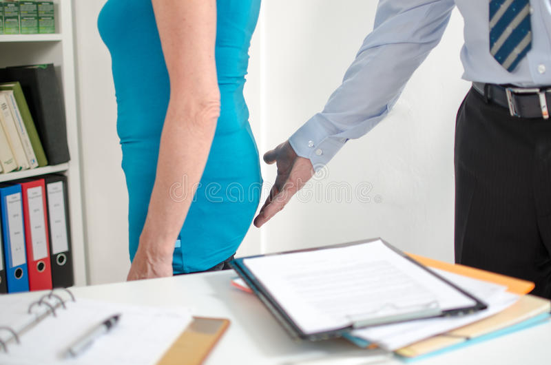 Sexual harassment. A sexual harassment at work royalty free stock photography