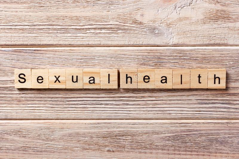 Sexual health word written on wood block. Sexual health text on table, concept royalty free stock photography