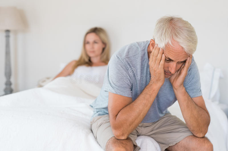 Sexual problem concept. Upset mature couple ignoring each other. Close up of a worried senior men in tension at bed. Senior couple angry with each other after a royalty free stock photos