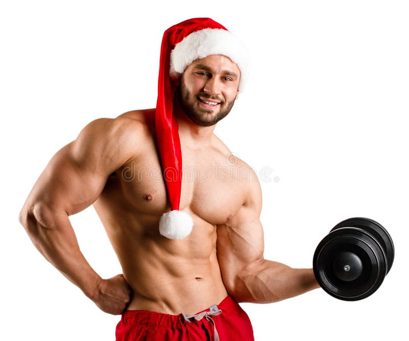 Strong ans Santa Claus with muscular body in red and white christmas santa hat, isolated, white background royalty free stock photo
