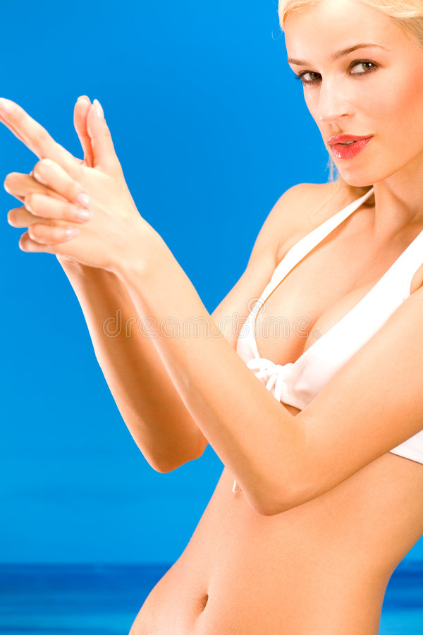 Sexual tanned blond woman stock photography