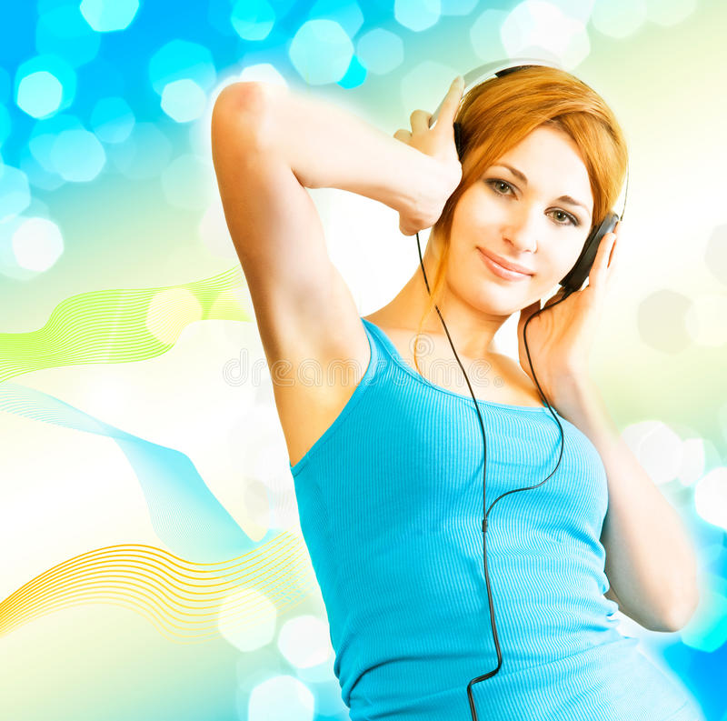 Sexual woman in headphones royalty free stock photo
