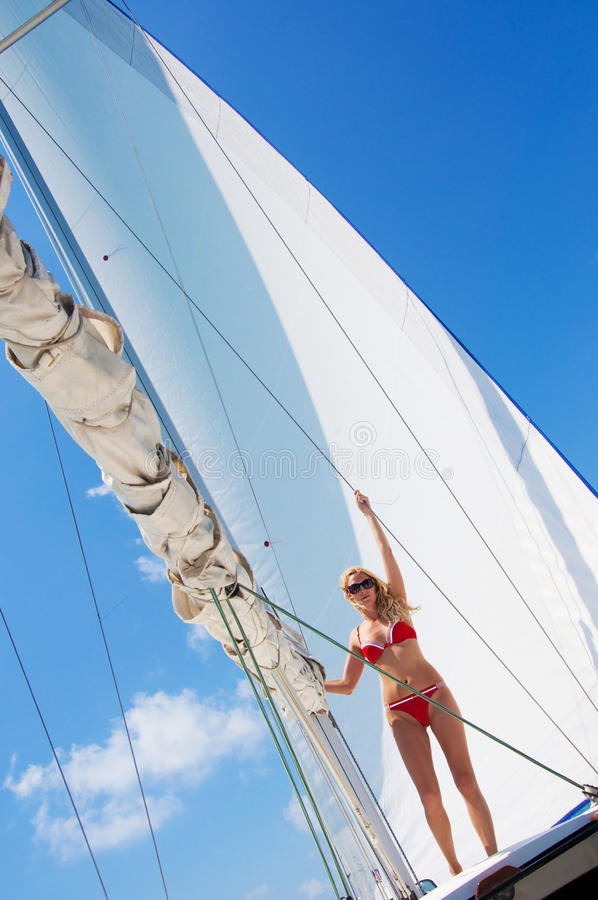 Sexual woman on luxurious sailboat royalty free stock image