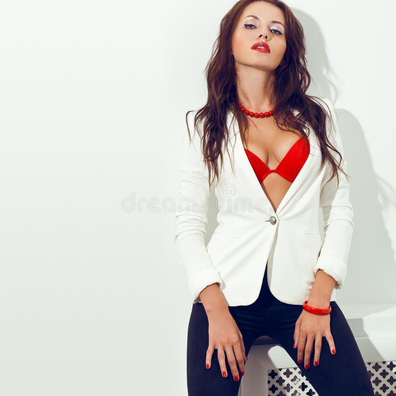 Sexual Woman Posing Over White Wall Stock Photo