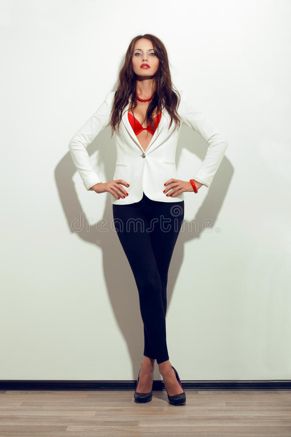 Sexual woman posing over white wall stock photography