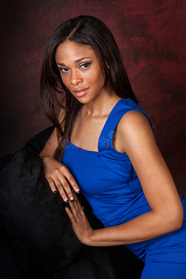 African American fashion model. Curvy African American fashion model in formal blue vibrant dress stock photography