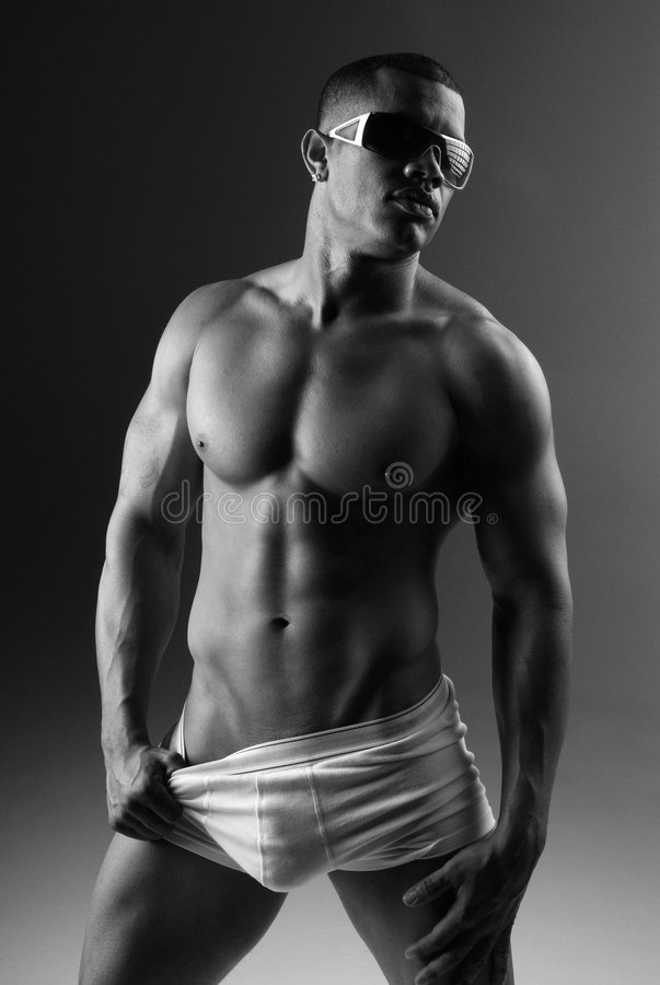 African American man. Muscular African American man wearing white underwear and sunglasses stock photo