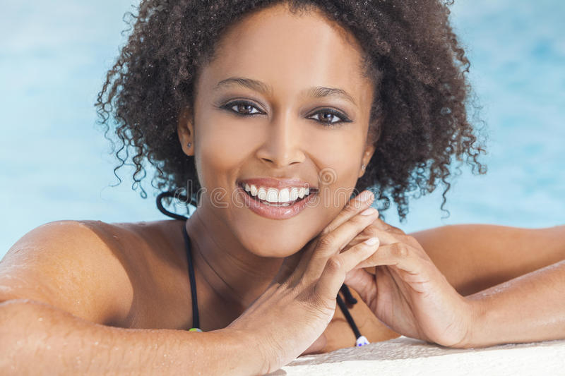 African American Woman Girl In Swimming Pool Royalty Free Stock Photography