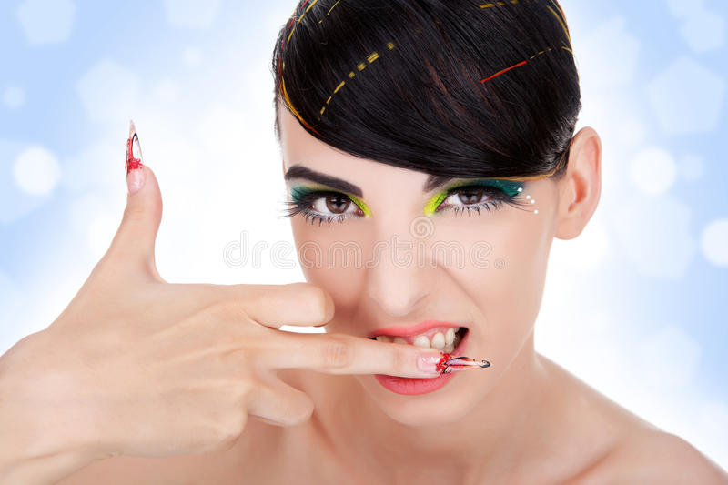 Download Aggressive Woman Biting Her Middle Finger Stock Photo - Image: 22844114