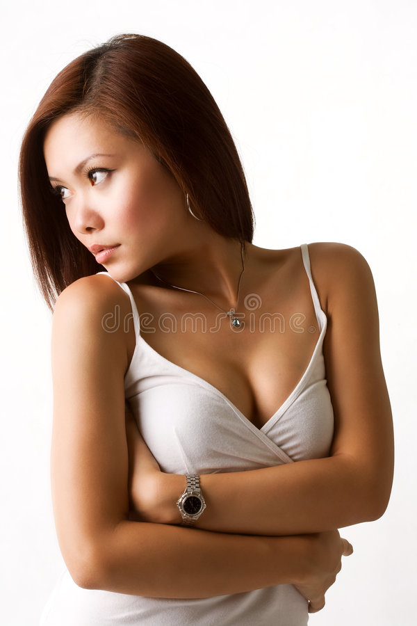 Sexy alluring asian woman looking to the side