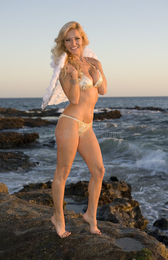 Angel on the Beach. At Sunset royalty free stock photography