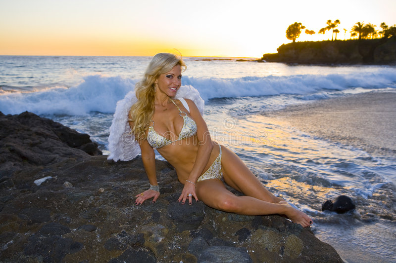 Angel Smiling on the Beach. Fantasy Angel Smiling on the Beach in Laguna royalty free stock photo