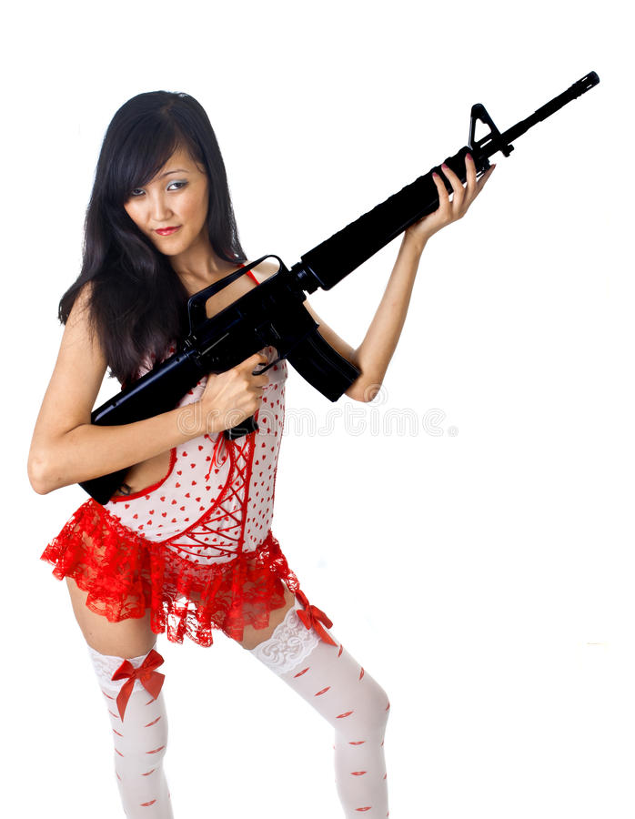 asian female with rifle stock photography