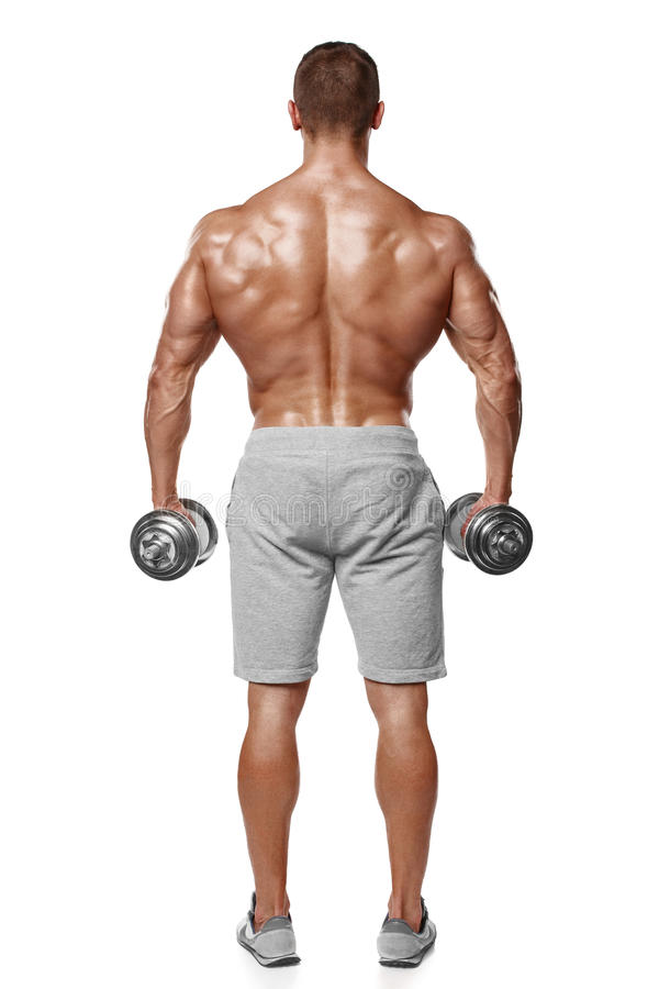 Athletic man showing muscular body with dumbbells, rear view, full length, isolated over white background. Strong male naked. Torso royalty free stock photo