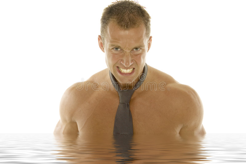 Athletic man with tie. Muscular man with tie - water effect stock image